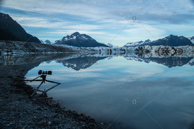 Telephoto lens and camera on a tripod in the bay near an Alaskan glacier