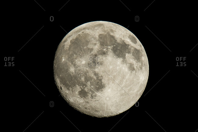Large full moon in a black night sky