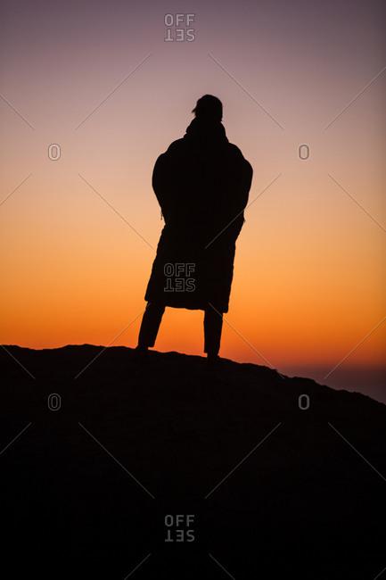 Man watching the sunrise