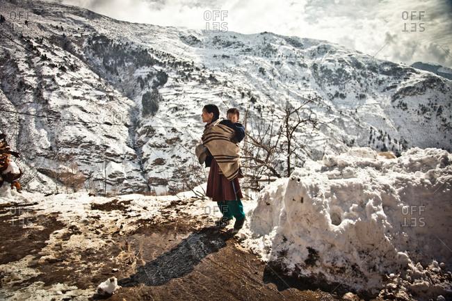 Humla, Nepal - February 16, 2014: Woman and child, Humla, Nepal