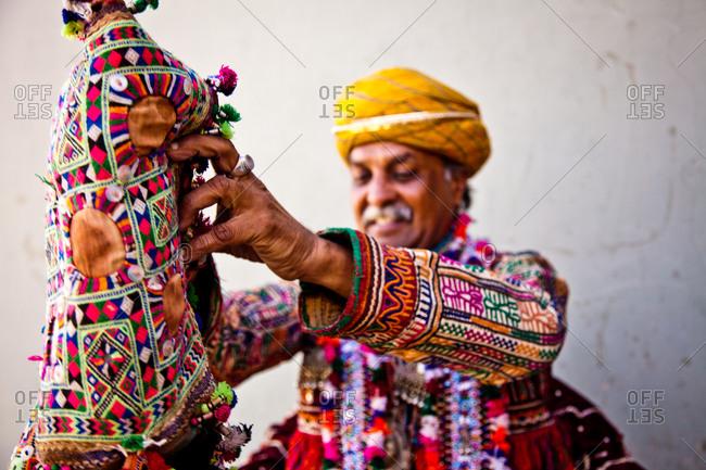 January 10, 2016: Camel decorator, Bikiner Camel Fair, Rajasthan, India
