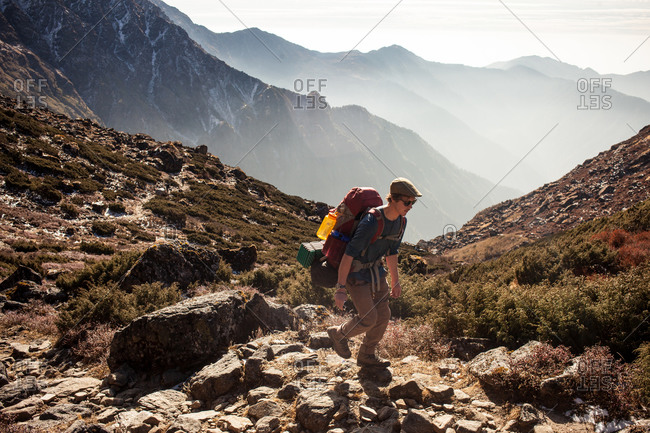 Gosikunda, Nepal - November 29, 2015: Man trekking along a rocky path, Gosikunda, Nepal