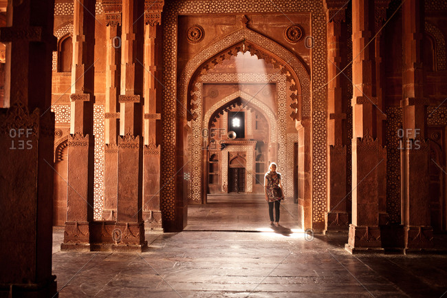Agra, India - January 4, 2016: Woman walking through the Fatehpur Sikri complex, near Agra, India