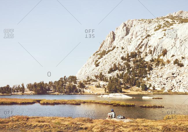Man by lake, Yosemite National Park