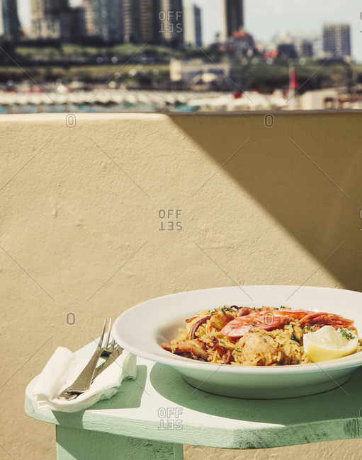 Dish of rice and seafood on balcony table