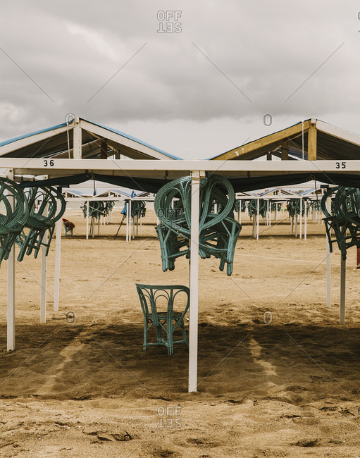 Beach shelters with hanging chairs