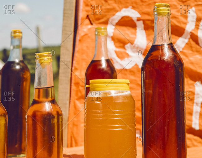 Bottles of honey for sale at a roadside stand