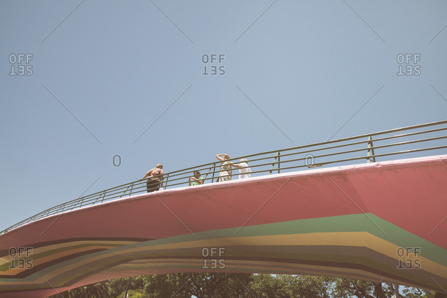 12/25/14 - Buenos Aires, Argentina:People on bridge with stripes painted on underside