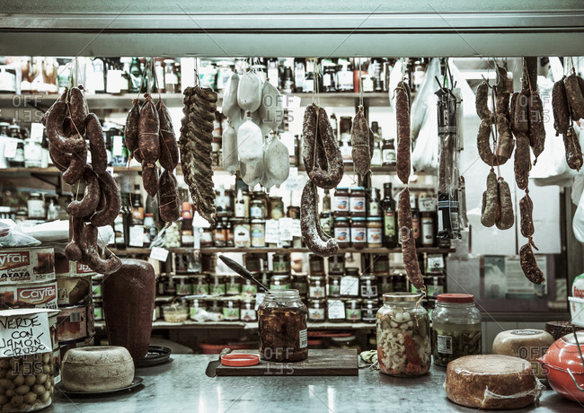 Sausages hang above counter in deli