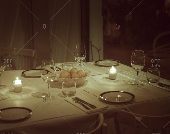 Dining table lit by candles