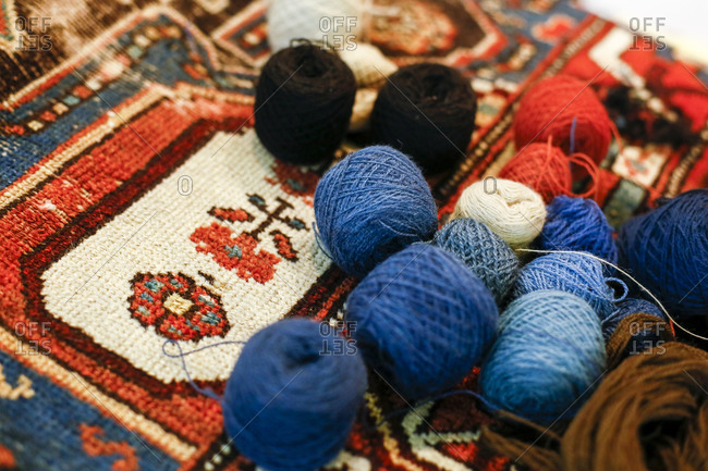 Close-up of a yarn skein on a patterned rug