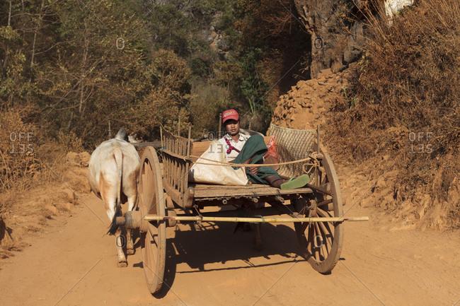 Myanmar - February 11, 2014: Teen sleeping on cart in Burma