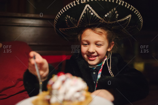 Girl wearing a sombrero celebrating at a birthday party