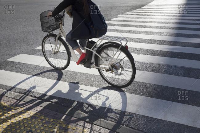 Bicycle passing through the Shibuya Crossing in Tokyo, Japan