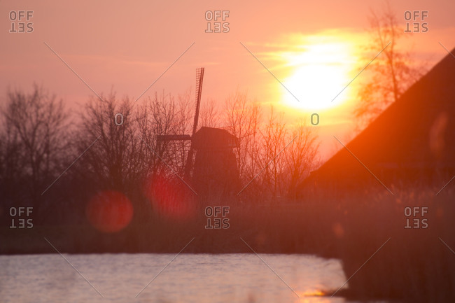 Sun over windmills in North Amsterdam, Holland, Netherlands