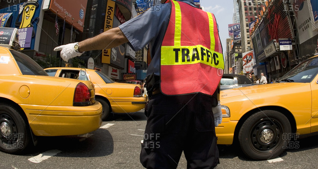 New York, NY, USA - June 1, 2007: Traffic policeman in Times Square, New York City, New York