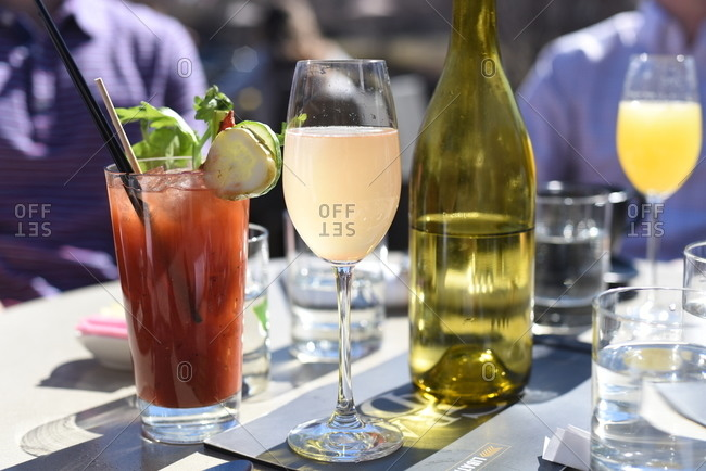 Bloody Mary and champagne cocktails on an outdoor table at brunch