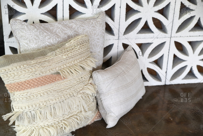 Throw pillows and decorative cement blocks