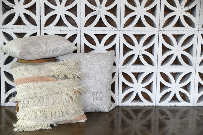 Decorative cement block wall with throw pillows