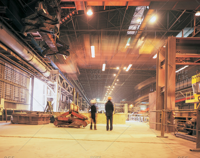 View of workers in steel mill