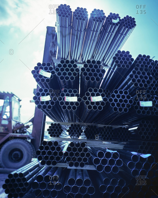 Forklift truck moving steel pipes in port, Grimsby, England, United Kingdom