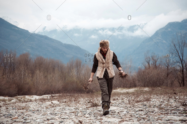 Mid adult man gathering firewood
