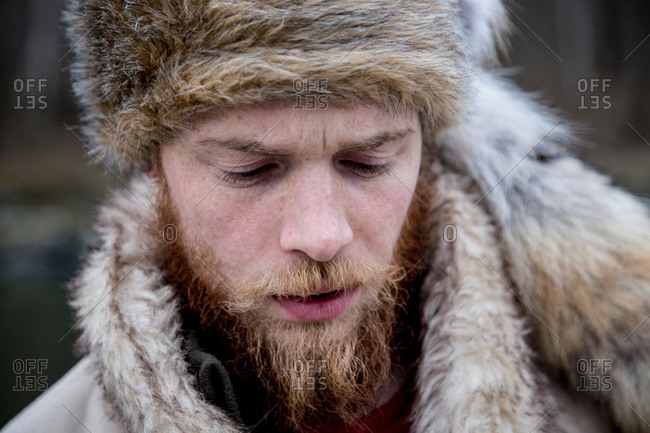 Close up of a mid adult man wearing trapper hat
