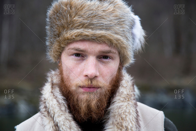 Mid adult man with a beard wearing trapper hat, portrait