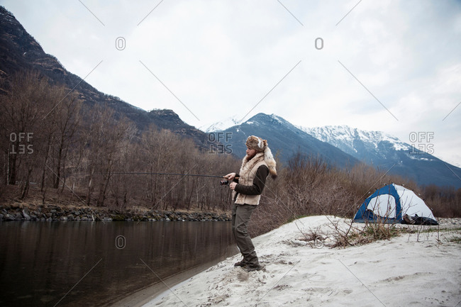 Mid adult man fishing - Offset
