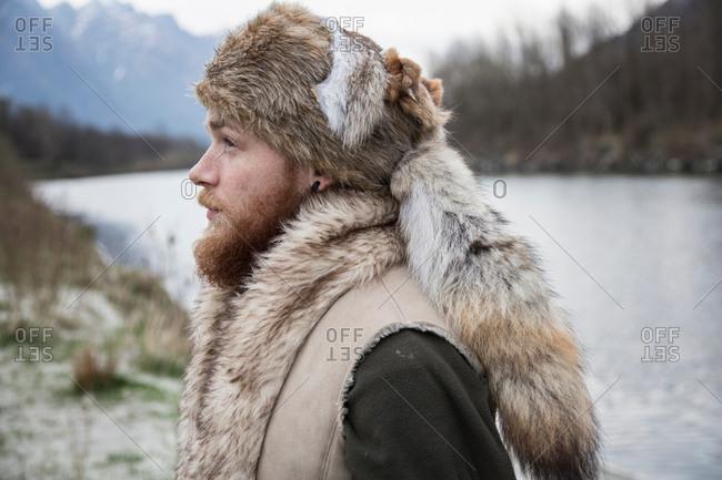 Mid adult man wearing trapper hat, portrait