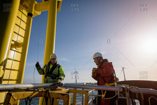 Engineers about to climb wind turbine on offshore wind farm