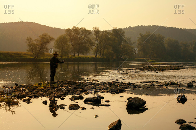 Mid adult man fishing in lake, Sarsy village, Sverdlovsk region, Russia