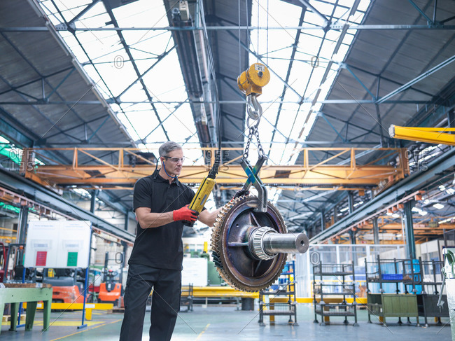Worker assembling industrial gearbox
