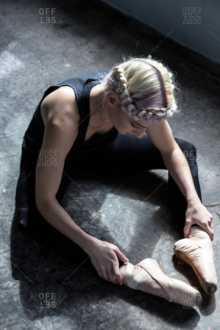 Above view of a dancer stretching in studio