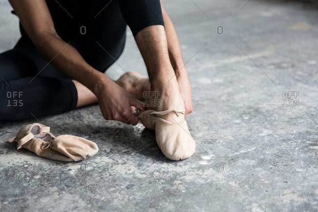 Dancer wearing slippers in studio