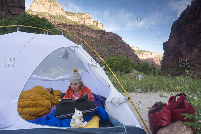 A mother and daughter camping along the Gates of Lodore, Green River, Dinosaur National Monument, Colorado.