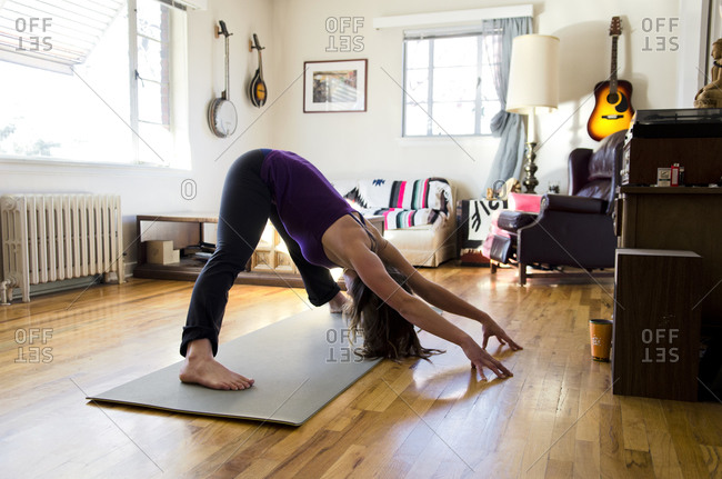 A young woman practices her morning yoga routine in Reno, Nevada.