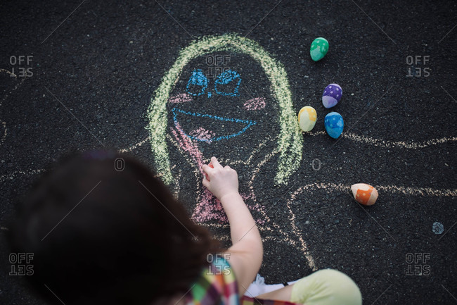 Picture being drawn on the ground with sidewalk chalk