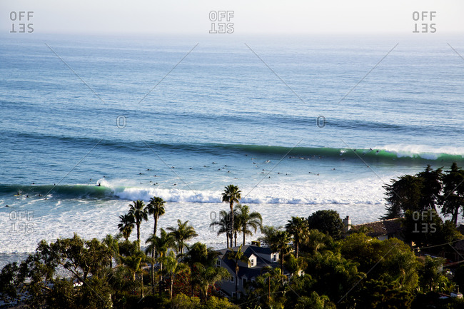 Aerial view of surfers in the water at the beach