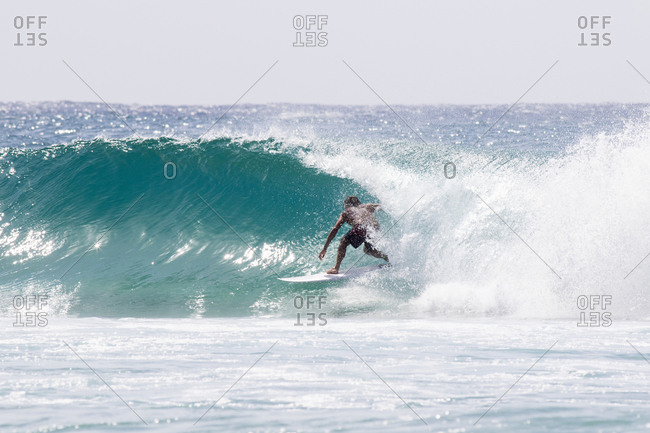 Surfer inside a barrel