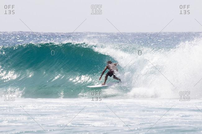Surfer inside a barrel