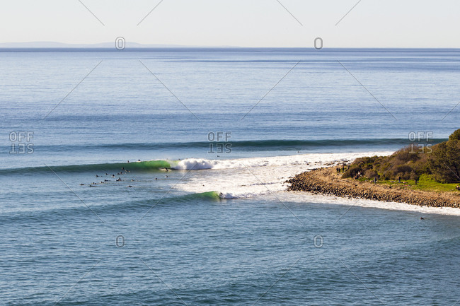 Aerial view of surfers catching waves