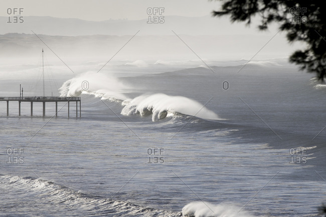 Large waves and a pier