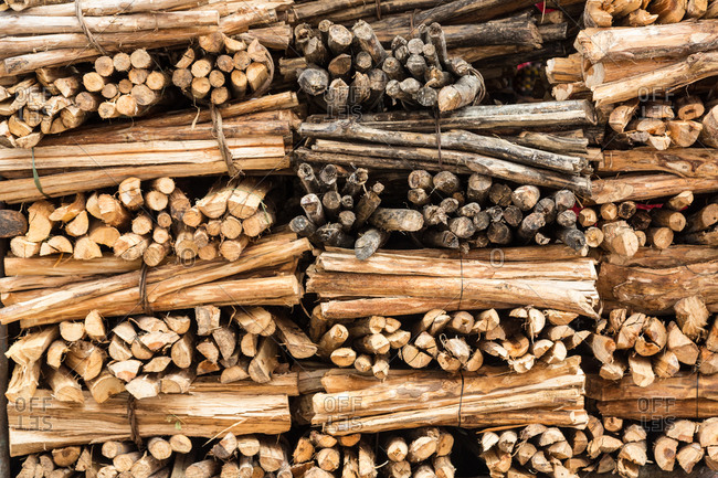 Close up of bundles of wood in stack at farmers market