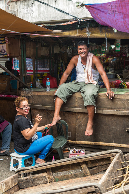 Davao City, Philippines - January 2, 2016: Portrait of man and woman at Bankerohan Public Market in Davao, Philippines