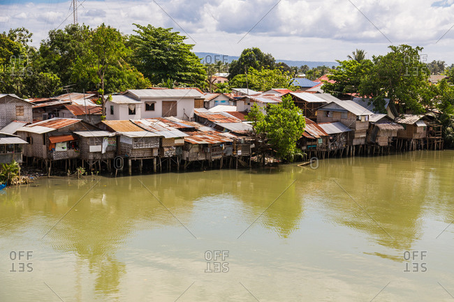 Residential shacks along river in Davao, Philippines