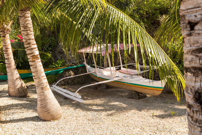 Double outrigger canoe on beach in the Philippines