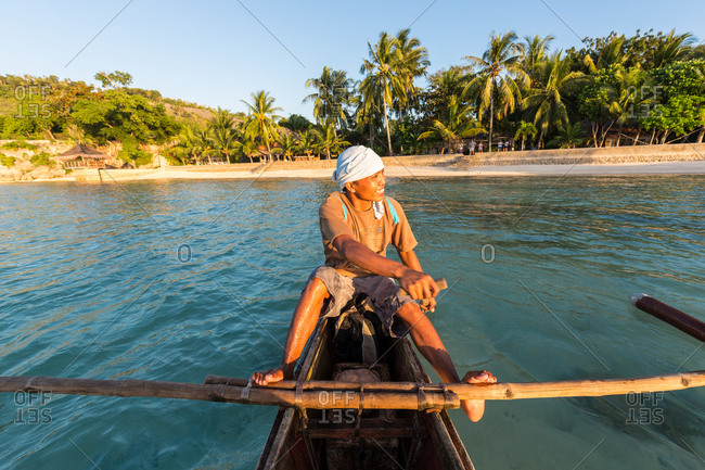 Ronda, Philippines - January 5, 2016: Portrait of a man paddling an outrigger canoe