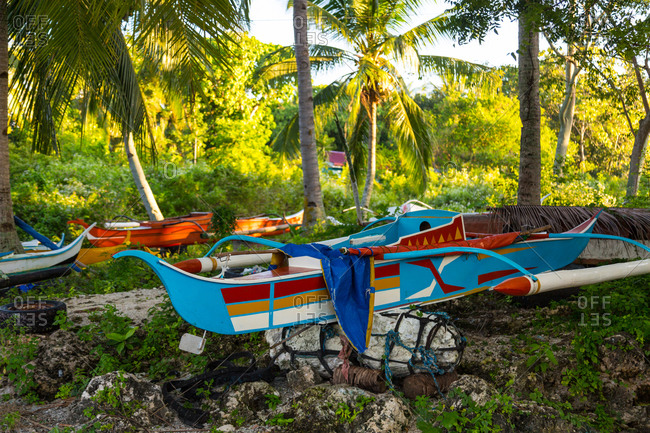 Colorfully painted traditional paraw boats in Cebu, Philippines