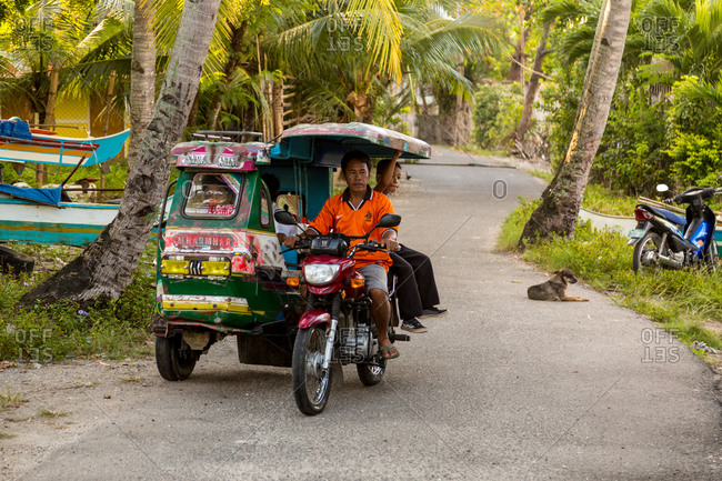 Ronda, Philippines - January 6, 2016: Motorcycle cart on road in Philippines